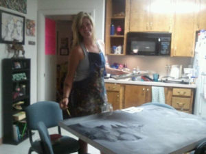 Painting a large piece of art for my collegiate senior show in our dorm room kitchen